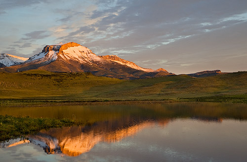 Ear Mountain reflcts into calm Lake Theboe along the Rocky Mountain Front in Montana